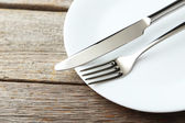 Fork, knife and plate — Stock Photo