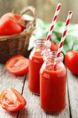 Fresh tomato juice in bottles — Stock Photo