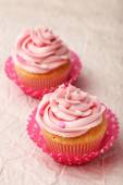 Tasty cupcakes on pink background — Stock Photo