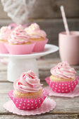 Tasty cupcakes on grey background — Stock Photo
