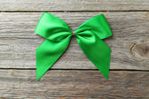 Green bow on grey background — Stock Photo