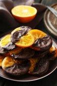 Slices of orange coated chocolate — Stockfoto