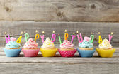 Birthday cupcakes with candles — Stock Photo