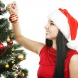 Woman decorating  christmas tree — Stock Photo #65766323