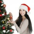 Woman decorating christmas tree — Stock Photo #65766487