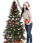 Woman decorating christmas tree — Stock Photo #65766635