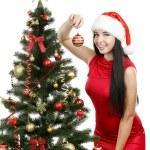 Woman decorating christmas tree — Stock Photo #65766707