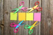 Colored figured scissors with papers — Stockfoto