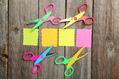 Colored figured scissors with papers — Stock Photo