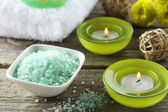 Sea salt in white bowl with candles — Stock Photo
