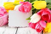 Beautiful tulips with card — Stock Photo
