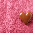Chocolate heart on paper background — Stock Photo #69614901