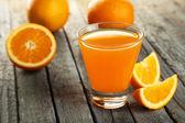 Glass of fresh orange juice — Stock Photo