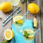 Fresh lemonade with lemons — Stock Photo #70590277