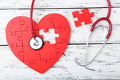 Red puzzle heart with stethoscope — Stock Photo