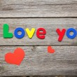 I love you words made of colorful magnets — Stock Photo #71401579
