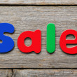 Sale word made of colorful magnets — Stock Photo #71401627