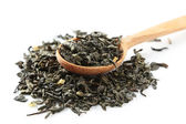 Dry tea in spoon — Stock Photo