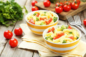 Delicious pasta in bowls — Stock Photo