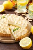 Lemon meringue pie on cutting board — Stock Photo