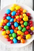 Colorful candies on plate — Stock Photo
