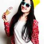 Fashion girl eating ice cream — Stock Photo #75408601
