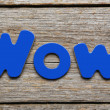 Wow word made of colorful magnets — Stock Photo #75810869