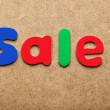 Sale word made of colorful magnets — Stock Photo #75810557