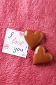 Chocolate hearts with romantic card — Stock Photo