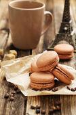 Coffee macarons with coffee beans — Stock Photo