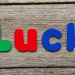 Luck word made of colorful magnets — Stock Photo #79652834
