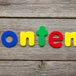 Content word made of colorful magnets — Stok fotoğraf #79653020