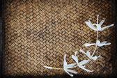 Close up Thai flower on bamboo mat — Stock Photo