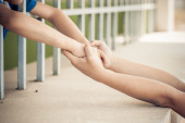 Two kid hand hold together — Stock Photo
