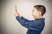 Young boy excite with  american dollar bank note — Stock Photo