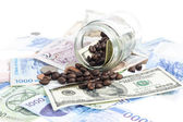 Coffee bean with Several kind of bank notes and coin — Stock Photo