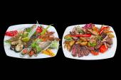 Mixed grill on plates — Stock Photo