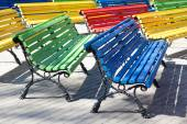 Multicolored wooden benches — Stock Photo