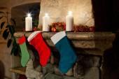 Christmas stockings on fireplace — Stock Photo