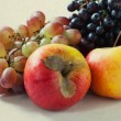 Apples and purple grapes — Stock Photo #64634675