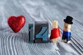 Love concept. Valentines day. 14 february. Romantic couple. Man, woman and read heart. Clothespins. (Soft focus, 14 written with colored vintage letterpress) — Stock Photo