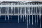 Icicles on the roof. winter season — Stock Photo