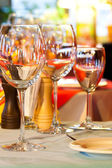 Served table charger. Wine glasses, plate and cutlery. — Stock Photo