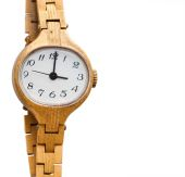 Golden wristwatch on the white background — Stock Photo