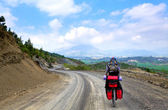 Cyclist riding on mountain serpentine in Turkey — Stock Photo