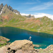 Man admiring a beautiful lake in the mountains — Stock Photo #70394635