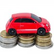 Toy car on top of stacks of coins — Stock Photo #62936285