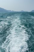 View of waves behind a boat — Stock Photo