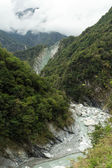 Landscape of lush mountains, ravine and a river — Stockfoto