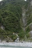 Waterfall and Eternal Spring Shrine at steep mountain at Taroko, Taiwan — ストック写真